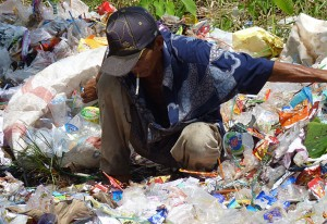 Sorting through plastic garbage, an open dump on a school ground in Banjarmasin, South Kalimantan, November 2012